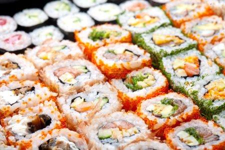Variety of japanese sushi rolls.