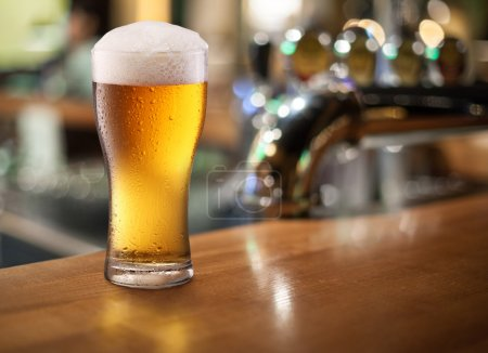 Photo for Photo of cold beer glass on a bar. Closeup. - Royalty Free Image