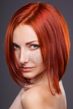 Red hair. Beautiful Woman with Short Hair