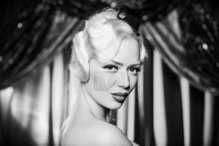 Retro portrait of beautiful blonde woman. Vintage style