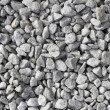 Gray white stones that act as gravel for drainage ...