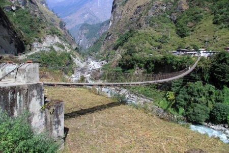 Big suspension bridge near village on the Annapurn...