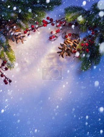 Blue snow Christmas background, frame of fir branches