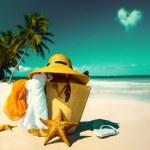 Art Straw hat, bag, sun glasses and flip flops on ...