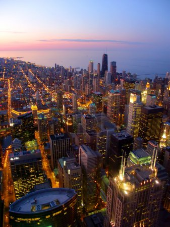 Photo for Chicago, USA - June 07, 2005: Beautiful sunset over downtown Chicago and Lake Michigan. The city of Chicago was incorporated in 1837 and is one of the largest cities in the United States. - Royalty Free Image