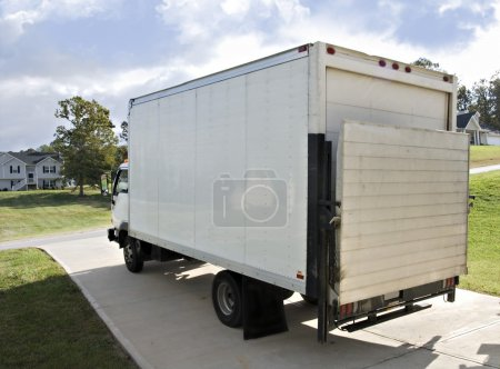 Photo for A large truck in the driveway of a home ready to be loaded or unloaded. - Royalty Free Image