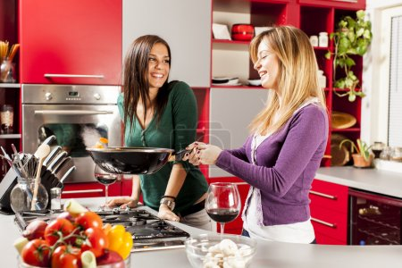 Photo for Young women in the kitchen - Royalty Free Image