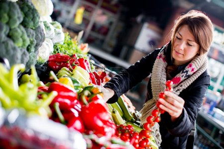 Young woman at the market...