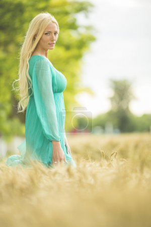 Photo for Young blond woman in the field - Royalty Free Image