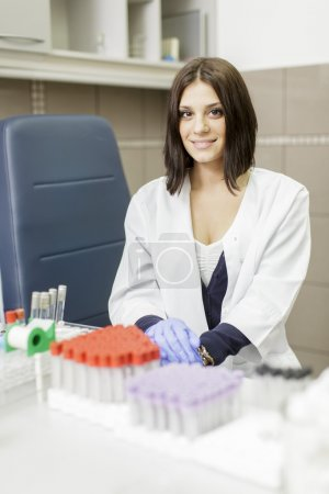 Young woman in the medical laboratory