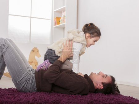 Father and daughter playing in the room