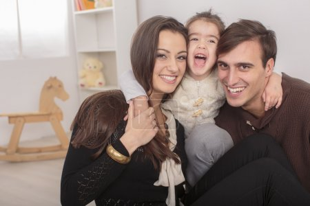 Happy family sitting in the room
