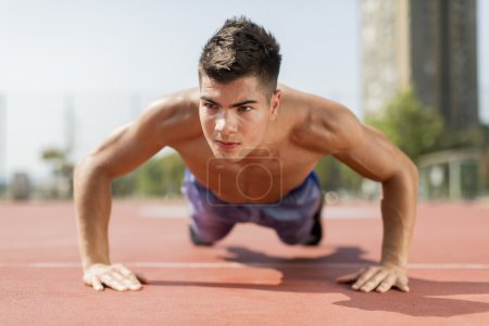 Photo for Summer sport. Sporty man is exercising outside - Royalty Free Image