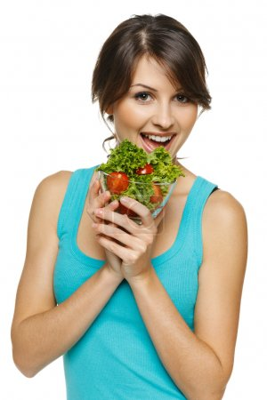 Woman eating healthy salad meal