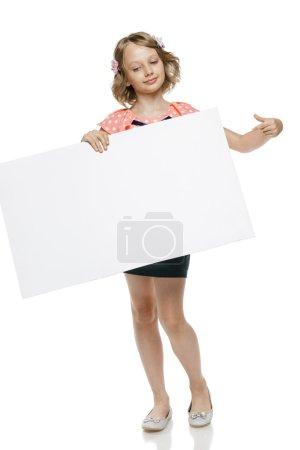 Girl holding blank whiteboard