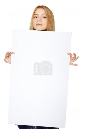 Girl holding peeking out the adge of blank banner