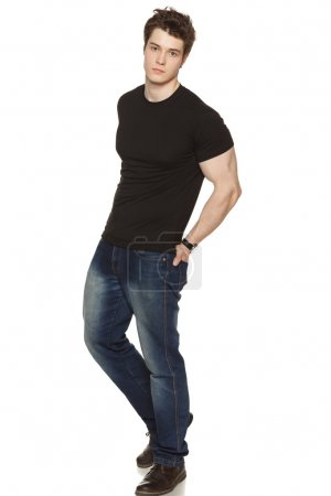 Young man with his hands in his rear pockets