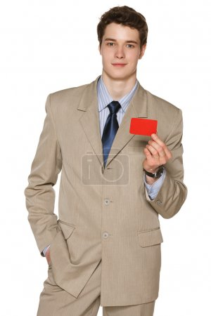Business man holding blank credit card