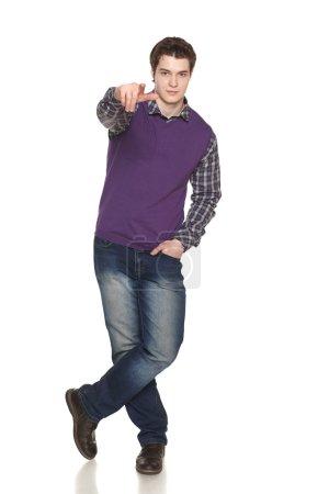 Full length man pointing at you