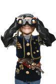 Girl wearing costume of pirate looking away through the binoculars