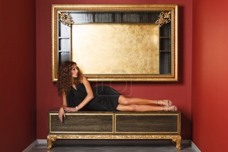 Fashion models posing in glamorous interior