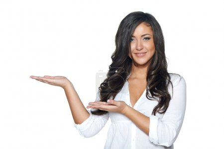 Woman holding blank copy space on her open palm