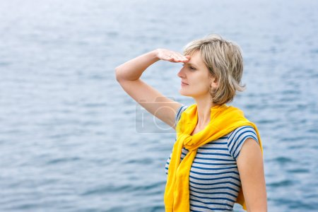 Middle age woman outdoors  looking in distance