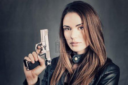 woman holding up her gun
