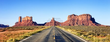 panoramic view of long road at Monument Valley