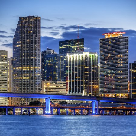 Photo for CIty of Miami Florida, illuminated business and residential buildings and bridge on Biscayne Bay - Royalty Free Image
