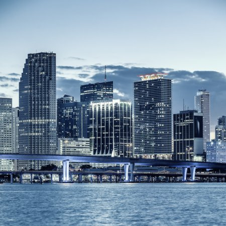 Photo for CIty of Miami Florida, business and residential buildings and bridge on Biscayne Bay - Royalty Free Image