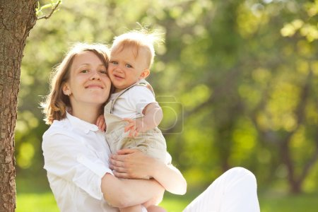 Photo for Young mother and her son spending time outdoor on a summer day - Royalty Free Image