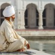 Sikh in a obliteration prayer In the lotus positio...
