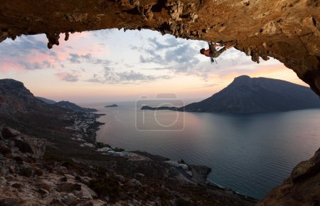 Photo for Silhouette of a rock climber against picturesque view of Telendos Island at sunset. Kalymnos Island, Greece. - Royalty Free Image