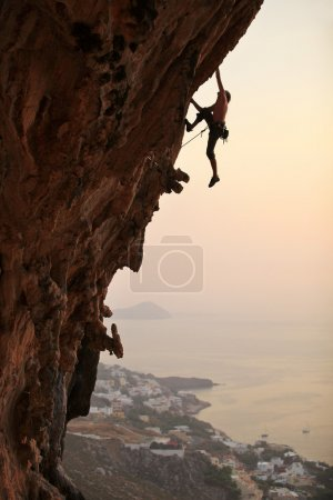 Photo for Rock climber at sunset, Kalymnos Island, Greece - Royalty Free Image