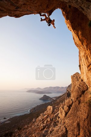 Photo for Rock climber at sunset, Kalymnos Island, Greece - Royalty Free Image