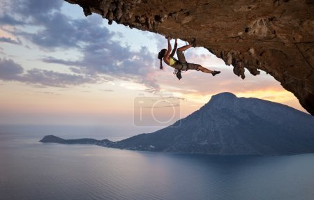 Photo for Young female rock climber at sunset, Kalymnos Island, Greece - Royalty Free Image