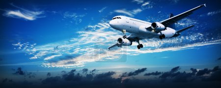 Photo for Panoramic composition of a flying jet in a sunset sky - Royalty Free Image