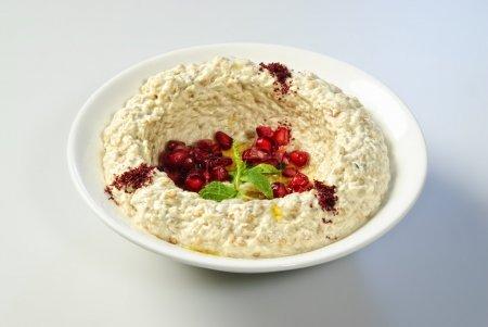 Oriental Arabic food hummus with pomegranate seeds