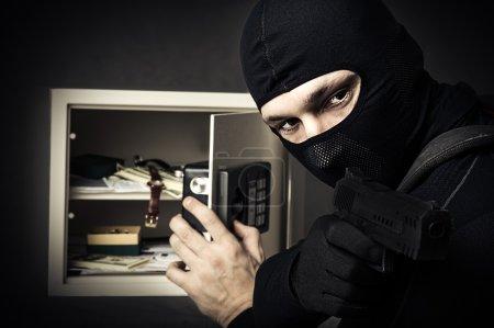 Professional burglar in black mask