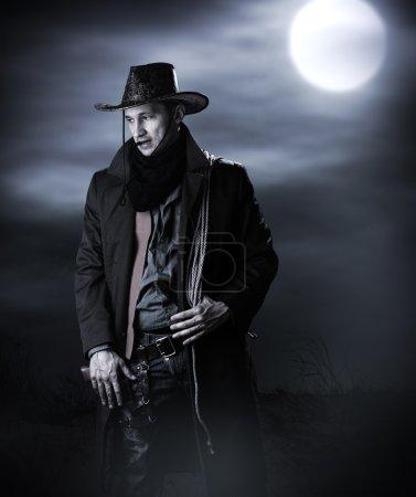 Handsome man in cowboy costume