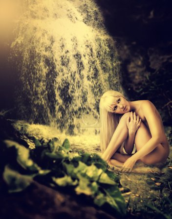 Lagoon, waterfall and sexy blond woman