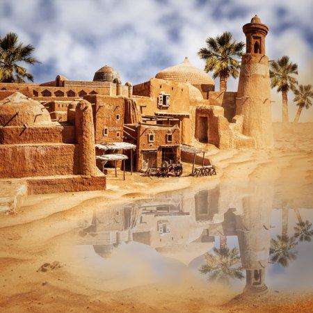 vieille ville de fantaisie et de lac dans le désert