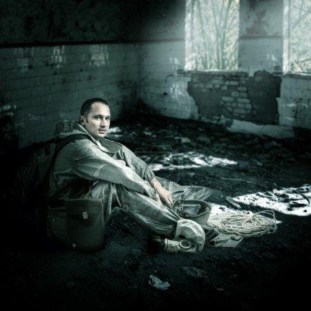 Military man in ruins of buildings