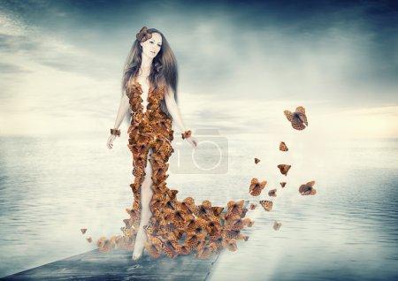 Beautiful young woman in butterflies dress
