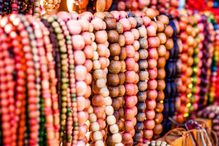 Wooden colored beads on display on the market inZakopane, Poland