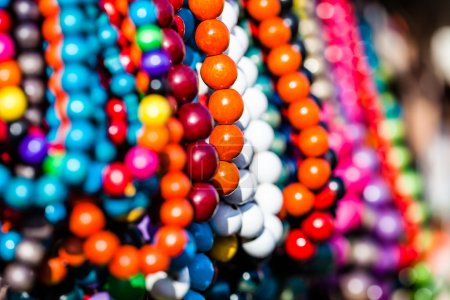 Wooden colored beads on display on the market in Zakopane, Poland