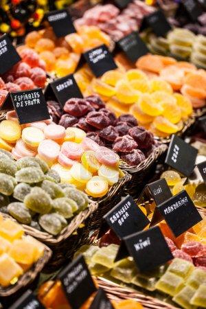 Market stall full of candys in La Boqueria Market. Barcelona. Catalonia.