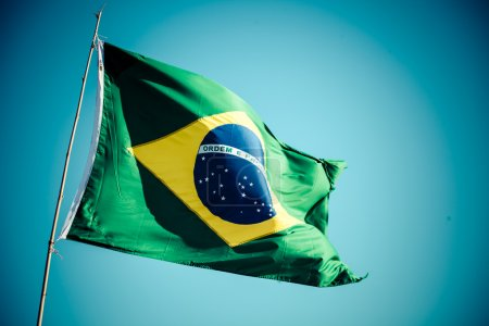The national flag of Brazil (Brasil) flutters in t...