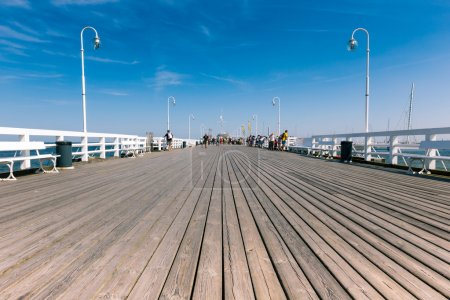 SOPOT, POLAND - 9 AUGUST: People on Sopot molo at Baltic Sea, 9 august 2014. Sopot is major health and tourist resort destination and this pier with 511.5 meters long is the longest wooden pier in Eur